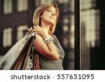 Happy Young Woman With Shoppin...