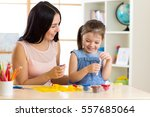 child girl and mom play with...   Shutterstock . vector #557685064