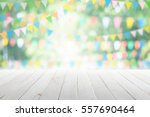 empty wooden table with party... | Shutterstock . vector #557690464
