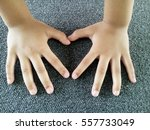children hands concept heart on ... | Shutterstock . vector #557733049
