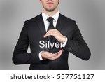 businessman in suit protecting... | Shutterstock . vector #557751127