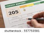 women checking credit score in... | Shutterstock . vector #557753581