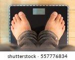 foot of man standing on...   Shutterstock . vector #557776834