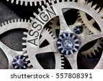 Small photo of Macro photo of tooth wheel mechanism with ASSIGN concept letters