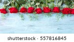 Stock photo red roses on blue wooden background valentines day background with red roses wedding background 557816845
