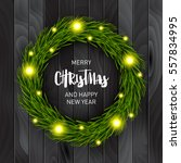 christmas wreath on a wooden... | Shutterstock .eps vector #557834995
