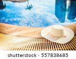 Straw Hat Be Side Of Swimming...