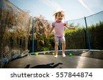Little Child Jumping On Big...