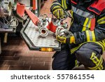 Firefighter In Action To The...