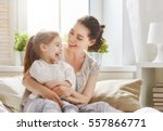 happy loving family. mother and ... | Shutterstock . vector #557866771