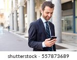 businessman in the city looking ... | Shutterstock . vector #557873689