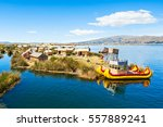 uros floating island near puno... | Shutterstock . vector #557889241