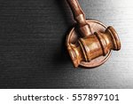 judge's gavel over black... | Shutterstock . vector #557897101