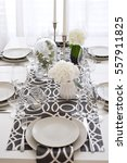 white and grey table setting... | Shutterstock . vector #557911825