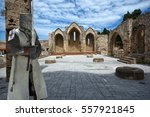 Small photo of Medieval knight in ruins of the Church of the Virgin of the Burgh in the Old Town of Rhodes, Greece