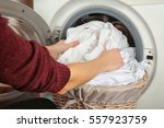 female hands getting out clean... | Shutterstock . vector #557923759