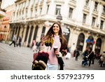 young woman with  coffee to go... | Shutterstock . vector #557923795