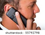 A close up of a man talking on a mobile phone - stock photo