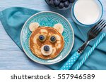 funny pancake in a shape of... | Shutterstock . vector #557946589