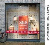 sale signs in display window of ... | Shutterstock . vector #557953951