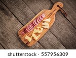 cheese and salami on kitchen... | Shutterstock . vector #557956309