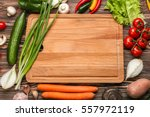 cutting board and vegetables on ... | Shutterstock . vector #557972119