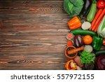 fresh vegetables on wooden... | Shutterstock . vector #557972155