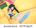 latin american dad playing with ... | Shutterstock . vector #557976619