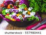 crisp spring salad with feta... | Shutterstock . vector #557980441