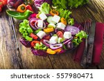 crisp spring salad with feta... | Shutterstock . vector #557980471