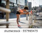 woman is stretching before... | Shutterstock . vector #557985475