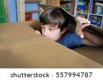 young boy is playing hide and... | Shutterstock . vector #557994787