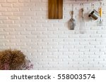 some kitchenware hang on white... | Shutterstock . vector #558003574