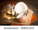 ripe half cut coconut on a... | Shutterstock . vector #558011191