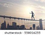 brave boy walking on a wire... | Shutterstock . vector #558016255