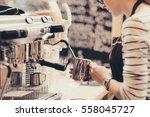 barista preparing coffee in a... | Shutterstock . vector #558045727