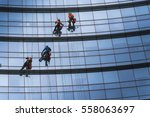 window washers cleaning the... | Shutterstock . vector #558063697
