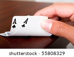 A poker player with pocket aces in his hand - stock photo