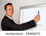 A business man presenting a growth chart - stock photo