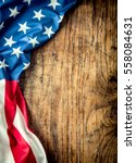 Small photo of American flag freely lying on wooden board.