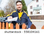 mailman passing letters to... | Shutterstock . vector #558104161