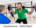 man in fitness club lifting... | Shutterstock . vector #558123667