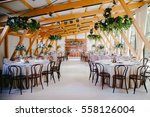 wedding reception in wooden... | Shutterstock . vector #558126004