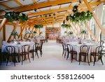 wedding reception in wooden... | Shutterstock . vector #558126004
