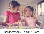 girls playing with lego blocks... | Shutterstock . vector #558142525