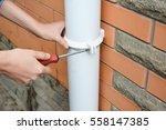 Worker Installing Rain Gutter...