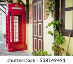 red telephone box in street... | Shutterstock . vector #558149491