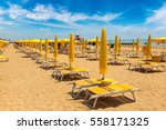 umbrellas on the beach of lido... | Shutterstock . vector #558171325