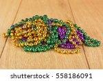 green  purple  and gold mardi... | Shutterstock . vector #558186091