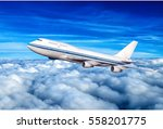 Small photo of passenger airplane in the clouds. travel by air transport. flying to the top of the airliner. nobody